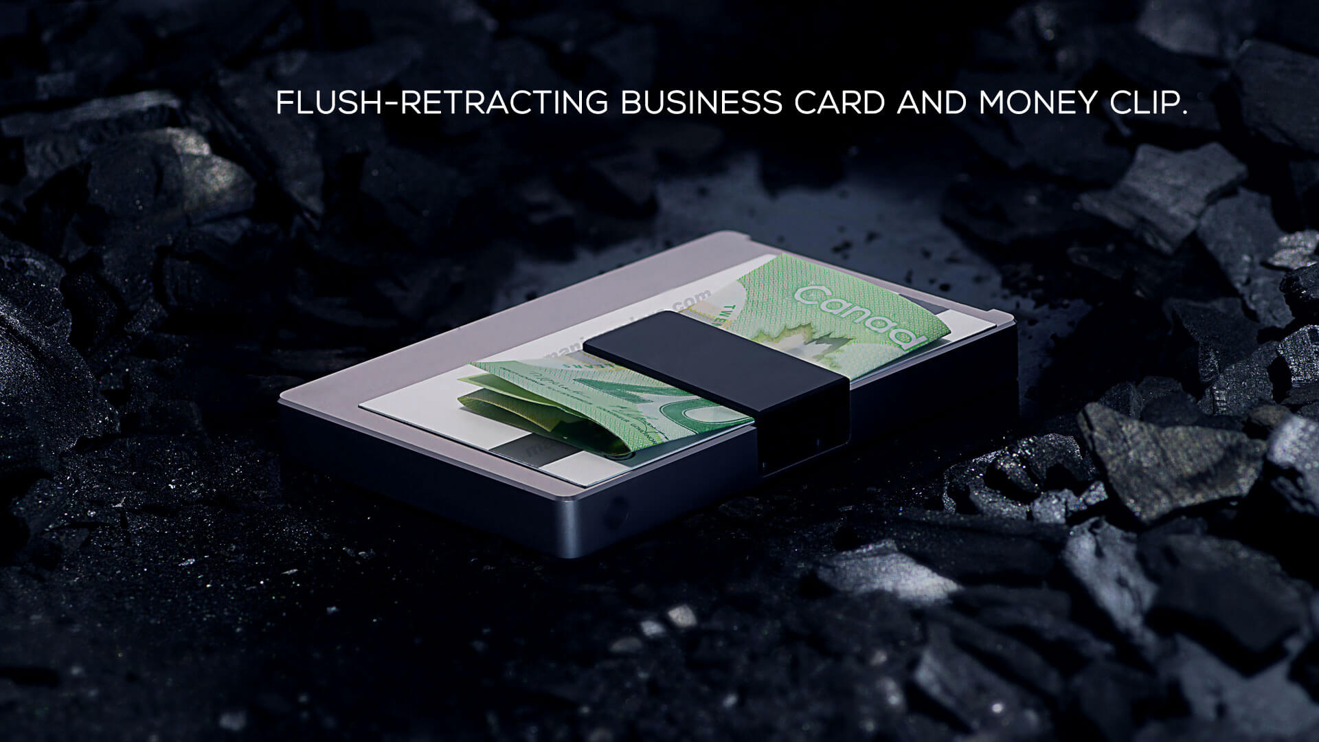 Flush-retracting business card and money clip.